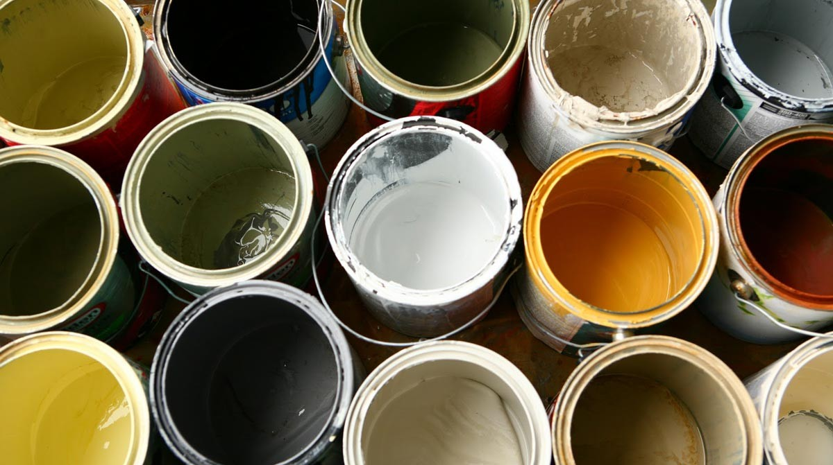 Old cans of paint representing old oil based paint.