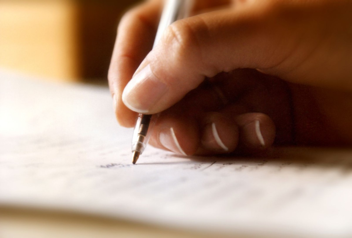 Image of person writing a letter