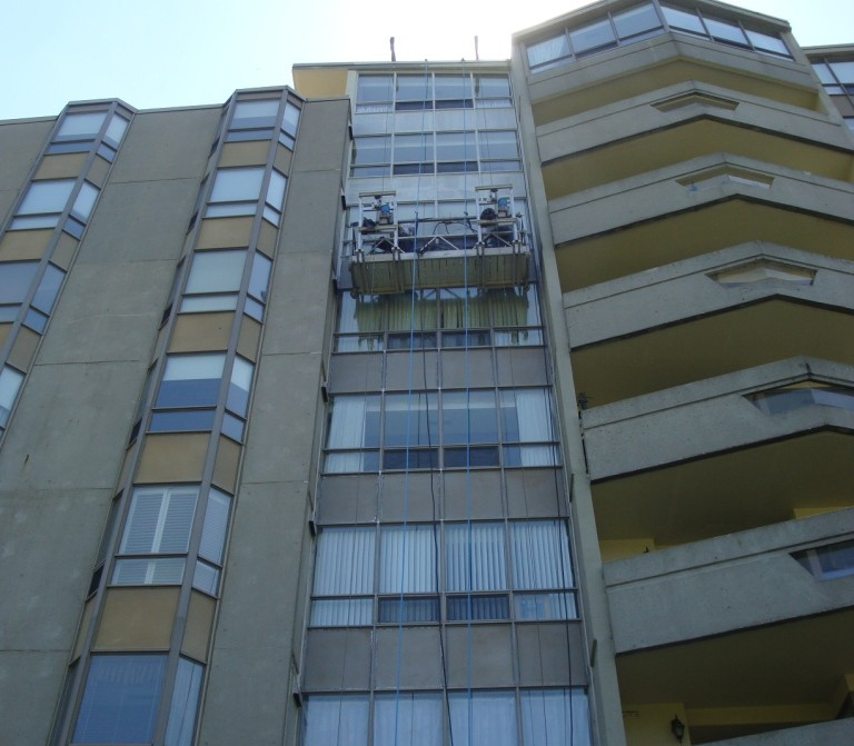 High rise painting on scaffolding armourco