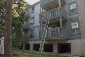 ArmourCo employees painting the balcony of these stacked townhomes