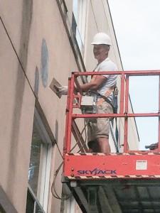 exterior condominium repairs being completed